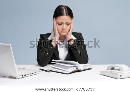 Sad business woman in office working with white table, laptop and diary personal organizer. Problem!