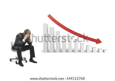 sad businessman sitting on chair with falling 3d graph