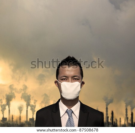 sad businessman with  mask and air pollution concept