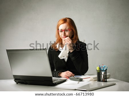 Sad businesswoman crying in front of a laptop