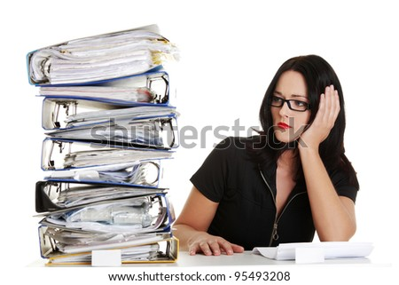 Sad businesswoman sitting behind the desk, isolated on white background