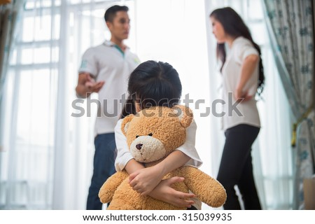 Sad child from this father and mother arguing, family negative concept. #315039935