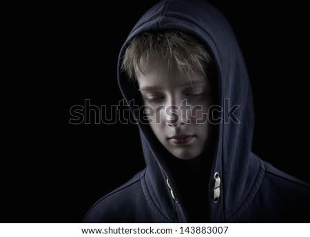 sad child on black