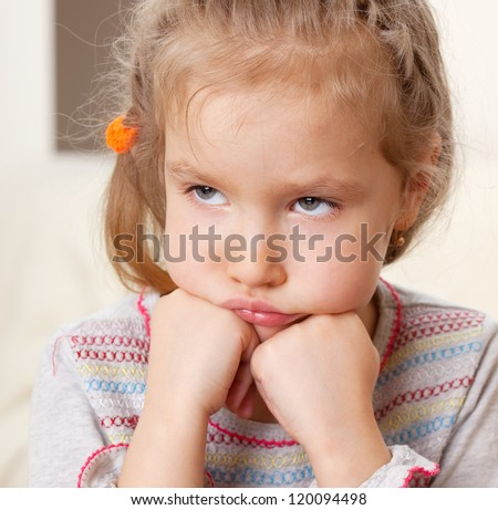Sad child. Worried little girl