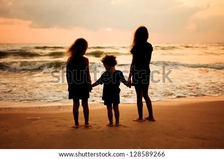 sad children on the beach