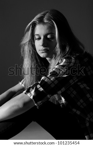 Sad college student. Black and white photography