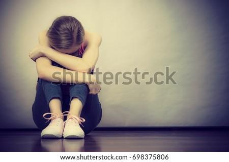 sad depressed young teenage...