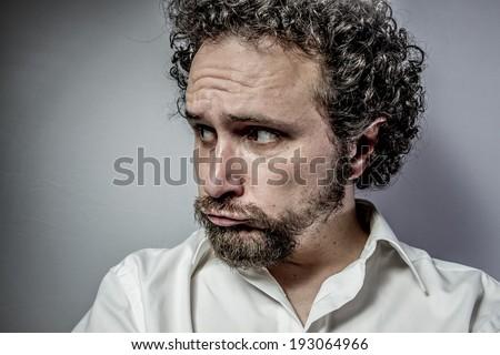 sad face, man with intense expression, white shirt