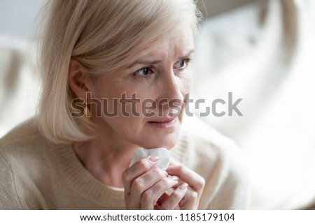Sad frustrated mature old woman in tears feeling blue thinking of loneliness sorrow grief, upset thoughtful middle aged woman crying worried about problems, depressed senior widow mourning grieving