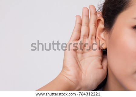 sad frustrated unhappy woman listening ear to bad news or having hearing impair, hard of hearing ストックフォト ©