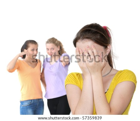 Sad girl against laughing friends isolated over white