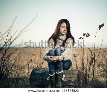 sad girl at fall season meadow