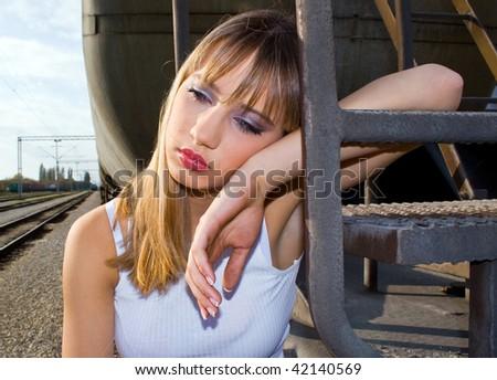 crying sad girl images. stock photo : sad girl crying near the rails