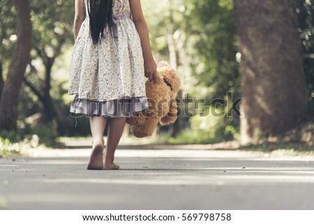 sad girl feeling alone in the...