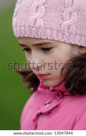 Sad girl in pink cap look depressed