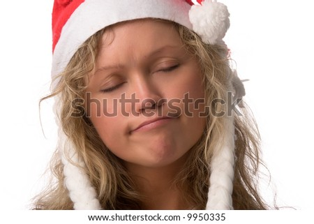 sad girl in Santa's red hat, isolated on white background
