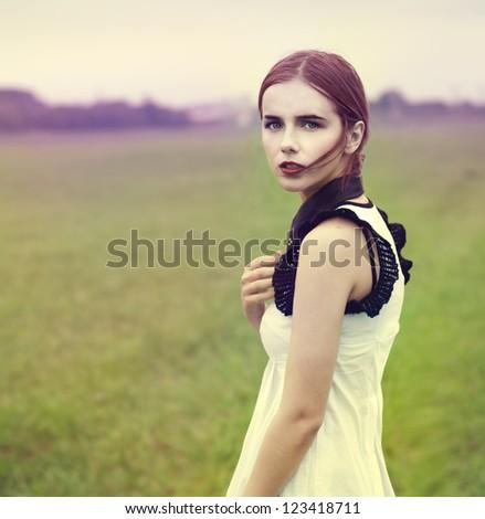 sad girl in the autumn field
