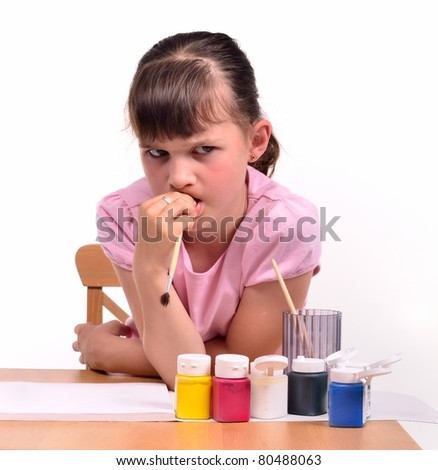Sad girl waiting for inspiration wishing to paint a picture isolated on white background