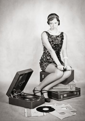 Sad girl with a gramophone. Retro