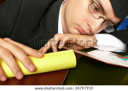 Sad graduate - stock photo
