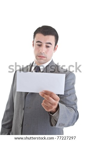 Sad Hispanic man looking at a blank envelope, focus on envelope