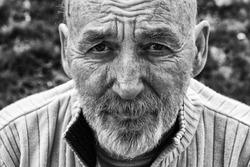 Sad homeless senior man