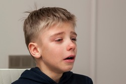 sad hurt little boy is crying. Eye drop, tear drop of little sweetheart kid. Emotional child miss his mom. Childhood concept
