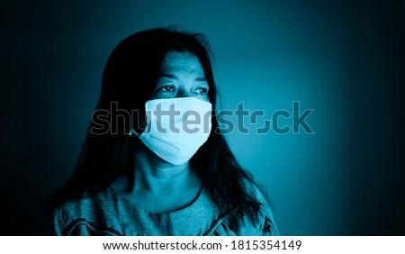 Sad indian senior mature woman at lockdown at home.quarantine for COVID-19 Coronavirus social distancing.Mental healthcare.depressed thinking senior indian woman in office.Covid19 Healthcare medical.