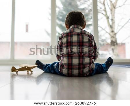 Sad kid sitting on floor