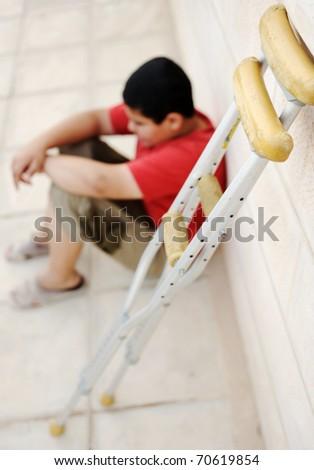 Sad kid with spikes on the street