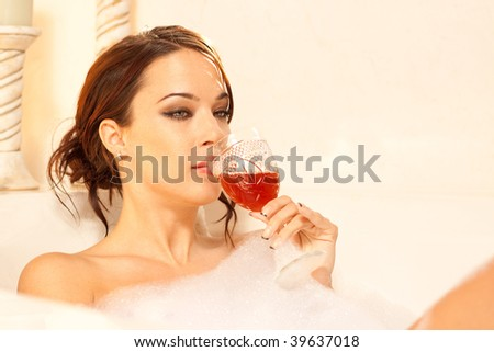 Sad lady drinking in the bath