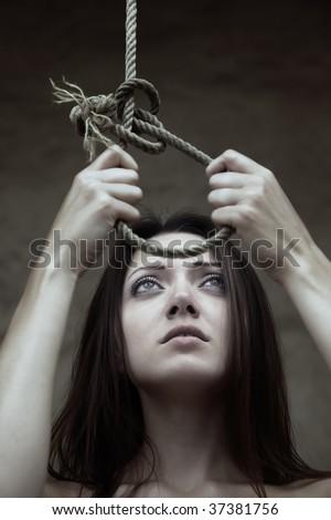 Sad lady holding the slipknot of the scaffold