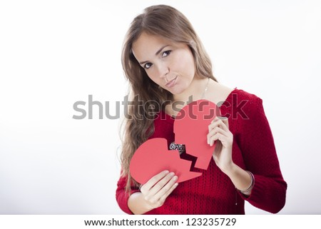 Sad latin young woman with a broken heart