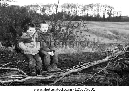 sad little boy in the countryside - stock photo