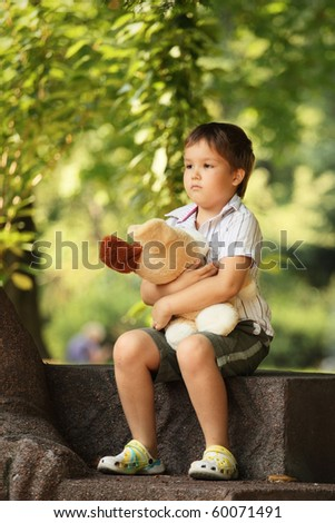 sad little boy in the park