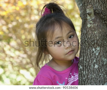Sad lonely Asian girl by tree