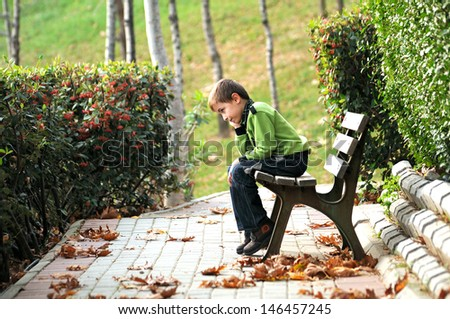 sad lonely child in the park