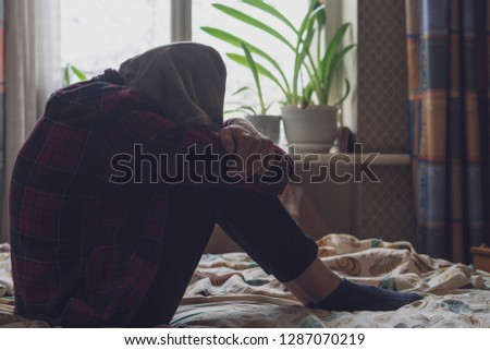 sad lonely teenager having trouble and cry in bedroom