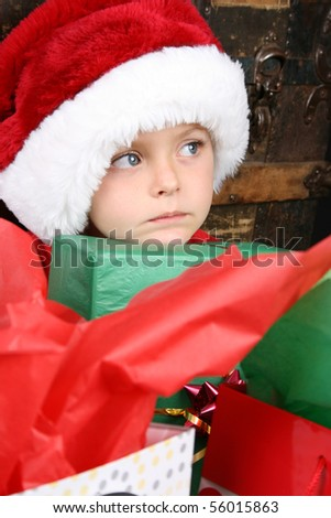 Sad looking boy, looking into the distance - stock photo