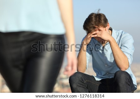 Sad man complaining outdoors after break up. Girlfriend leaving him #1276118314