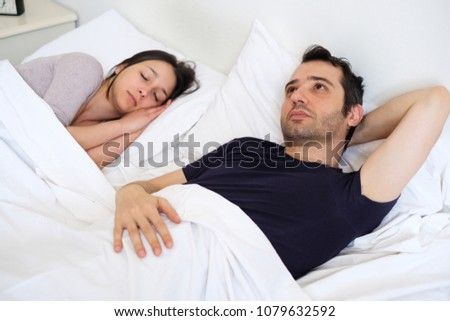 Sad man on the bed depressed for sexual problem with his girlfriend