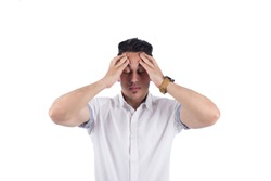 Sad man putting his hand over his forehead, showing tiredness sign, isolated on a white background.