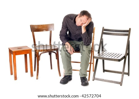 sad man sit on chair and thinking about problems