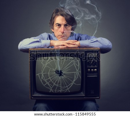 Sad man with a broken retro TV.