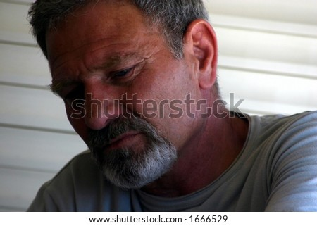 Sad Man with Gray Hair and Goatie- Portrait