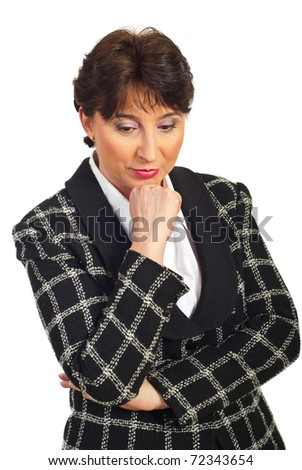 Sad mature business woman holding hand to ching and looking down isolated on white background