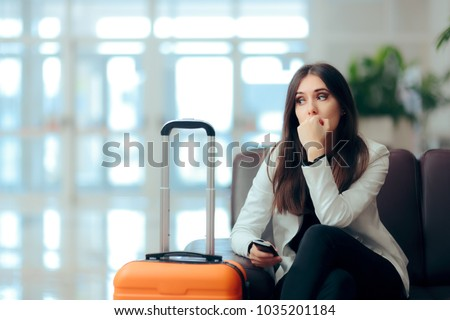 Sad Melancholic Woman with Suitcase in Airport Waiting Room. Upset girl traveling along waiting for the next flight