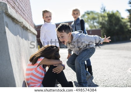 sad moment Elementary Age Bullying in Schoolyard Stock foto ©