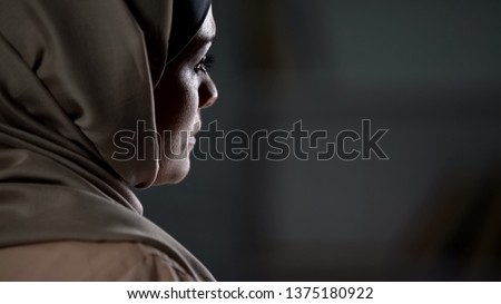 Sad muslim lady in hijab suffering from unhappy marriage, family problems