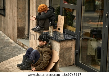 sad orphans children begging in town streets, it's cold outdoors, need shelter and monety to survive Zdjęcia stock ©